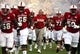 Sep 9, 2017; Raleigh, NC, USA; North Carolina State Wolfpack head coach Dave Doeren (center) leads his team onto the field prior to a game against the Marshall Thundering Herd at Carter-Finley Stadium. Mandatory Credit: Rob Kinnan-USA TODAY Sports