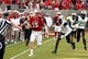 Sep 9, 2017; Raleigh, NC, USA; North Carolina State Wolfpack quarterback Ryan Finley (15) runs the ball as Marshall Thundering Herd defensive back Brandon Drayton (8) defends during the first half at Carter-Finley Stadium. Mandatory Credit: Rob Kinnan-USA TODAY Sports
