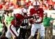 Sep 9, 2017; Raleigh, NC, USA; North Carolina State Wolfpack quarterback Ryan Finley (15 ) hands the ball off to  running back Nyheim Hines (7) during the first half against the Marshall Thundering Herd at Carter-Finley Stadium. Mandatory Credit: Rob Kinnan-USA TODAY Sports