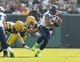 Sep 10, 2017; Green Bay, WI, USA; Seattle Seahawks quarterback Russell Wilson (3) is sacked by Green Bay Packers linebacker Nick Perry (53) during the first quarter at Lambeau Field. Mandatory Credit: Jeff Hanisch-USA TODAY Sports