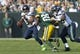 Sep 10, 2017; Green Bay, WI, USA; Seattle Seahawks quarterback Russell Wilson (3) scrambles out of the pocket under pressure from Green Bay Packers safety Kentrell Brice (29) during the second quarter at Lambeau Field. Mandatory Credit: Jeff Hanisch-USA TODAY Sports