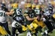 Sep 10, 2017; Green Bay, WI, USA; Green Bay Packers quarterback Aaron Rodgers (12) eludes Seattle Seahawks linebacker Frank Clark (55) in a NFL game at Lambeau Field. Mandatory Credit: Dan Powers/The Post-Crescent via USA TODAY Sports