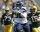 Sep 10, 2017; Green Bay, WI, USA; Seattle Seahawks defensive tackle Nazair Jones (92) runs down field after intercepting a pass thrown by Green Bay Packers quarterback Aaron Rodgers (12) during the first quarter during a NFL game at Lambeau Field. Mandatory Credit: Mark Hoffman/Milwaukee Journal Sentinel via USA TODAY Sports