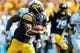 Sep 16, 2017; Iowa City, IA, USA; Iowa Hawkeyes running back Akrum Wadley (25) runs the ball against the North Texas Mean Green during the first quarter at Kinnick Stadium. Mandatory Credit: Jeffrey Becker-USA TODAY Sports