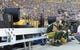Sep 24, 2017; Green Bay, WI, USA; Green Bay Packers players sit on the bench in front of misters during the second quarter against the Cincinnati Bengals at Lambeau Field. Mandatory Credit: Jeff Hanisch-USA TODAY Sports