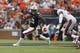 Oct 7, 2017; Auburn, AL, USA; Auburn Tigers receiver Eli Stove (12) gets past Ole Miss Rebels defensive back A.J. Moore (30) during the first quarter at Jordan-Hare Stadium. Mandatory Credit: John Reed-USA TODAY Sports