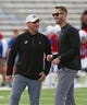 Oct 7, 2017; Lawrence, KS, USA; Kansas Jayhawks head coach David Beaty talks with Texas Tech Red Raiders head coach Kliff Kingsbury before the game at Memorial Stadium. Mandatory Credit: Jay Biggerstaff-USA TODAY Sports