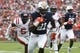 Oct 7, 2017; Auburn, AL, USA; Auburn Tigers running back Kerryon Johnson (21) scores a touchdown against the Ole Miss Rebels during the first quarter at Jordan-Hare Stadium. Mandatory Credit: John Reed-USA TODAY Sports