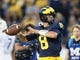 Oct 7, 2017; Ann Arbor, MI, USA; Michigan Wolverines quarterback John O'Korn (8) warms up prior to a game  against the Michigan State Spartans at Michigan Stadium. Mandatory Credit: Mike Carter-USA TODAY Sports