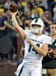 Oct 7, 2017; Ann Arbor, MI, USA; Michigan State Spartans quarterback Brian Lewerke (14) warms up prior to a game against the Michigan Wolverines at Michigan Stadium. Mandatory Credit: Mike Carter-USA TODAY Sports