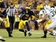 Oct 7, 2017; Ann Arbor, MI, USA; Michigan Wolverines running back Chris Evans (12) runs the ball during the first quarter of a game against the Michigan State Spartans at Michigan Stadium. Mandatory Credit: Mike Carter-USA TODAY Sports