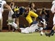 Oct 7, 2017; Ann Arbor, MI, USA; Michigan Wolverines wide receiver Eddie McDoom (13) is tripped up by Michigan State Spartans cornerback Justin Layne (2) during the first half of a game at Michigan Stadium. Mandatory Credit: Mike Carter-USA TODAY Sports