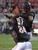 Oct 7, 2017; Las Vegas, NV, USA; UNLV Rebels quarterback Armani Rogers (1) celebrates with UNLV Rebels wide receiver Kendal Keys (84) after the two connected for a touchdown against the San Diego Aztecs at Sam Boyd Stadium. Mandatory Credit: Stephen R. Sylvanie-USA TODAY Sports