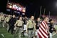 Oct 7, 2017; Las Vegas, NV, USA; UNLV Rebels players walk onto the field with first responder personnel during a pregame ceremony honoring those affected by the tragedy in Las Vegas before a game against the San Diego Aztecs at Sam Boyd Stadium. Mandatory Credit: Stephen R. Sylvanie-USA TODAY Sports