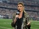 Oct 8, 2017; Arlington, TX, USA; Fox sideline reporter Erin Andrews on air prior to the game with the Green Bay Packers playing against the Dallas Cowboys at AT&T Stadium. Mandatory Credit: Matthew Emmons-USA TODAY Sports