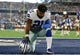 Oct 8, 2017; Arlington, TX, USA; Dallas Cowboys running back Ezekiel Elliott (21) takes a moment on a knee prior to the game against the Green Bay Packers at AT&T Stadium. Mandatory Credit: Matthew Emmons-USA TODAY Sports
