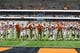 Oct 13, 2017; Syracuse, NY, USA; Clemson Tigers head coach Dabo Swinney walks with his players arm and arm during warm ups prior to the game against the Syracuse Orangeat the Carrier Dome. Mandatory Credit: Rich Barnes-USA TODAY Sports