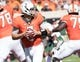 Oct 14, 2017; Stillwater, OK, USA; Oklahoma State Cowboys quarterback Mason Rudolph (2) rolls from the pocket during the first quarter against the Baylor Bears at Boone Pickens Stadium. Mandatory Credit: Rob Ferguson-USA TODAY Sports