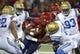 Oct 14, 2017; Tucson, AZ, USA; Arizona Wildcats quarterback Khalil Tate (14) is tackled by UCLA Bruins defensive back Adarius Pickett (6) during the first half at Arizona Stadium. Mandatory Credit: Casey Sapio-USA TODAY Sports