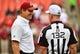 Oct 15, 2017; Landover, MD, USA; Washington Redskins head coach Jay Gruden  talks with referee John Parry (132) before the game between the Washington Redskins and the San Francisco 49ers at FedEx Field. Mandatory Credit: Brad Mills-USA TODAY Sports