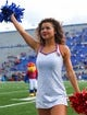 Oct 7, 2017; Lawrence, KS, USA; A Kansas Jayhawks cheerleader performs before the game against the Texas Tech Red Raiders at Memorial Stadium. Mandatory Credit: Jay Biggerstaff-USA TODAY Sports