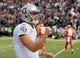 Oct 19, 2017; Oakland, CA, USA; Oakland Raiders quarterback Derek Carr (4) celebrates after a touchdown against the Kansas City Chiefs during the first quarter at Oakland Coliseum. Mandatory Credit: Kelley L Cox-USA TODAY Sports