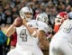 Oct 19, 2017; Oakland, CA, USA; Oakland Raiders quarterback Derek Carr (4) controls the ball against the Kansas City Chiefs during the second quarter at Oakland Coliseum. Mandatory Credit: Kelley L Cox-USA TODAY Sports