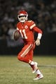 Oct 19, 2017; Oakland, CA, USA; Kansas City Chiefs quarterback Alex Smith (11) looks to throw a pass against the Oakland Raiders in the third quarter at Oakland Coliseum. The Raiders defeated the Chiefs 31-30. Mandatory Credit: Cary Edmondson-USA TODAY Sports
