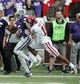 Oct 21, 2017; Manhattan, KS, USA; Kansas State Wildcats quarterback Alex Delton (5) is pushed out of bounds by Oklahoma Sooners cornerback Parnell Motley (11) during first quarter action at Bill Snyder Family Stadium. Mandatory Credit: Scott Sewell-USA TODAY Sports