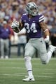 Oct 21, 2017; Manhattan, KS, USA; Kansas State Wildcats running back Alex Barnes (34) looks back for defenders as he crosses the goal line for a touchdown in the first quarter of a game against the Oklahoma Sooners at Bill Snyder Family Stadium. Mandatory Credit: Scott Sewell-USA TODAY Sports
