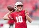 Oct 14, 2017; Madison, WI, USA; Wisconsin Badgers quarterback Jack Coan (10) during warmups prior to the game against the Purdue Boilermakers at Camp Randall Stadium. Mandatory Credit: Jeff Hanisch-USA TODAY Sports