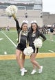 Nov 4, 2017; Columbia, MO, USA; Two Missouri Tigers cheerleaders pose for a photo before the game against the Florida Gators at Faurot Field. Mandatory Credit: Denny Medley-USA TODAY Sports