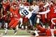 Nov 4, 2017; Fresno, CA, USA; Brigham Young Cougars defensive back Michael Shelton (18) is tackled by Fresno State Bulldog defenders during the first quarter at Bulldog Stadium. Mandatory Credit: Kiel Maddox-USA TODAY Sports