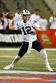 Nov 4, 2017; Fresno, CA, USA; Brigham Young Cougars quarterback Tanner Mangum (12) throws a pass during the first quarter against the Fresno State Bulldogs at Bulldog Stadium. Mandatory Credit: Kiel Maddox-USA TODAY Sports