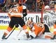 Nov 9, 2017; Philadelphia, PA, USA; Philadelphia Flyers goalie Brian Elliott (37) tries to cover the puck against the Chicago Blackhawks during the first period at Wells Fargo Center. Mandatory Credit: Eric Hartline-USA TODAY Sports