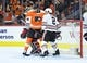 Nov 9, 2017; Philadelphia, PA, USA; Philadelphia Flyers center Sean Couturier (14) scores a goal against Chicago Blackhawks goalie Corey Crawford (50) and defenseman Duncan Keith (2) during the second period at Wells Fargo Center. Mandatory Credit: Eric Hartline-USA TODAY Sports