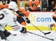Nov 9, 2017; Philadelphia, PA, USA; Philadelphia Flyers defenseman Shayne Gostisbehere (53) looks to pass the puck against the Chicago Blackhawks during the second period at Wells Fargo Center. Mandatory Credit: Eric Hartline-USA TODAY Sports
