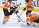 Nov 9, 2017; Philadelphia, PA, USA; Philadelphia Flyers goalie Brian Elliott (37) covers the puck as Chicago Blackhawks center Jonathan Toews (19) is held off by defenseman Robert Hagg (8) during the third period at Wells Fargo Center. Mandatory Credit: Eric Hartline-USA TODAY Sports