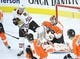 Nov 9, 2017; Philadelphia, PA, USA; Philadelphia Flyers goalie Brian Elliott (37) makes a save as Chicago Blackhawks left wing Lance Bouma (17) tries to deflect the puck during the third period at Wells Fargo Center. Mandatory Credit: Eric Hartline-USA TODAY Sports