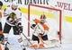 Nov 9, 2017; Philadelphia, PA, USA; Philadelphia Flyers goalie Brian Elliott (37) makes a save as Chicago Blackhawks center Artem Anisimov (15) looks for a rebound during the third period at Wells Fargo Center. Mandatory Credit: Eric Hartline-USA TODAY Sports