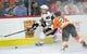 Nov 9, 2017; Philadelphia, PA, USA; Chicago Blackhawks right wing John Hayden (40) is checked by Philadelphia Flyers defenseman Brandon Manning (23) during the third period at Wells Fargo Center. Mandatory Credit: Eric Hartline-USA TODAY Sports