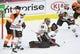 Nov 9, 2017; Philadelphia, PA, USA; Chicago Blackhawks goalie Corey Crawford (50) makes a save against the Philadelphia Flyers during the third period at Wells Fargo Center. Mandatory Credit: Eric Hartline-USA TODAY Sports