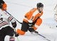 Nov 9, 2017; Philadelphia, PA, USA; Philadelphia Flyers defenseman Ivan Provorov (9) blocks a shot against Chicago Blackhawks left wing Brandon Saad (20) during the third period at Wells Fargo Center. Mandatory Credit: Eric Hartline-USA TODAY Sports