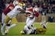 Nov 25, 2017; Stanford, CA, USA; Stanford Cardinal running back Bryce Love (20) gets tackled by the Notre Dame Fighting Irish defense during the first quarter at Stanford Stadium. Mandatory Credit: Sergio Estrada-USA TODAY Sports