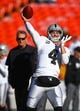 Dec 10, 2017; Kansas City, MO, USA; Oakland Raiders quarterback Derek Carr (4) warms up before the game against the Kansas City Chiefs at Arrowhead Stadium. Mandatory Credit: Jay Biggerstaff-USA TODAY Sports