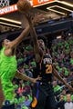 Dec 16, 2017; Minneapolis, MN, USA; Phoenix Suns forward Josh Jackson (20) shoots in the third quarter against the Minnesota Timberwolves center Karl-Anthony Towns (32) at Target Center. Mandatory Credit: Brad Rempel-USA TODAY Sports