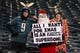 Dec 25, 2017; Philadelphia, PA, USA; Philadelphia Eagles fans dress up and hold a sign before a game against the Oakland Raiders at Lincoln Financial Field. Mandatory Credit: Bill Streicher-USA TODAY Sports