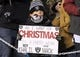 "Dec 25, 2017; Philadelphia, PA, USA; A youngster holds a sign that reads ""All I want for Christmas is a photo with Oakland Raiders defensive end Khalil Mack\"" during an NFL football game between the Raiders and the Philadelphia Eagles at Lincoln Financial Field. Mandatory Credit: Kirby Lee-USA TODAY Sports"