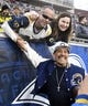 Jan 6, 2018; Los Angeles, CA, USA; American actor Danny Trejo poses with fans before the NFC Wild Card playoff football game between the Los Angeles Rams and the Atlanta Falcons at Los Angeles Memorial Coliseum. Mandatory Credit: Robert Hanashiro-USA TODAY Sports