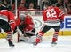 Jan 14, 2018; Chicago, IL, USA; Chicago Blackhawks goalie Jeff Glass (30) makes a save with defenseman Gustav Forsling (42) waiting to clear during the second period against the Detroit Red Wings at the United Center. Mandatory Credit: Dennis Wierzbicki-USA TODAY Sports
